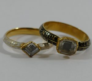 Two George III gold and enamel mourning rings, each set with a single quartz and bearing the same inscriptions SOLD - £3,400
