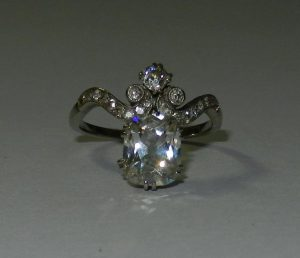 An early 20th century diamond ring, the old cushion cut diamond approximately 1.9 carats, VS clarity, F colour Est £2,000-£3,000 Included within a jewellery section of over 100 lots