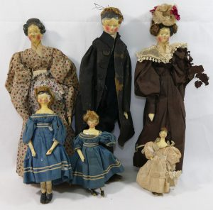Six 19th century Grodnertal style dolls and a selection of associated dolls house furniture SOLD £6,300