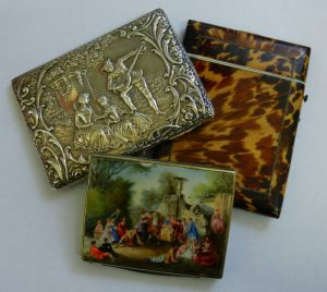 A large collection of card cases